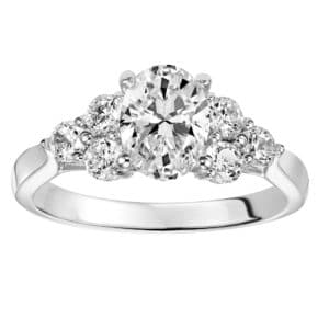 Oval Engagement with Diamond Clusters