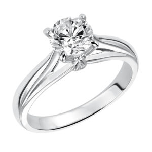 Solitaire Engagement Ring with Four Prong Setting and Surprise Diamond Accent