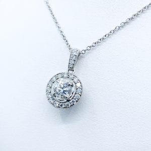 18K, 1.07 ctw. diamond halo pendant; GIA certified...