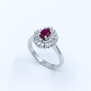 14K White Gold ring with oval ruby and baguette di...